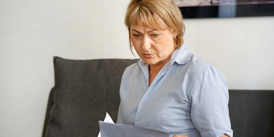 Middle-aged lady reading a letter