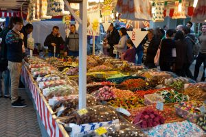 Busy local market stall selling sweets