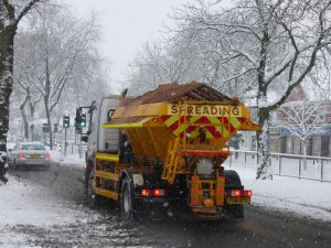 gritting lorry spreading salt in the snow