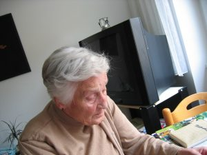 elderly woman at home by herself