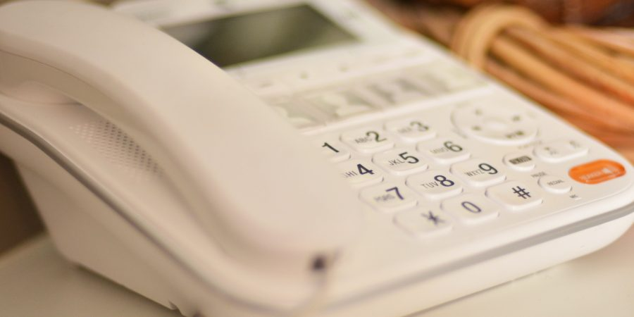 White traditional office telephone